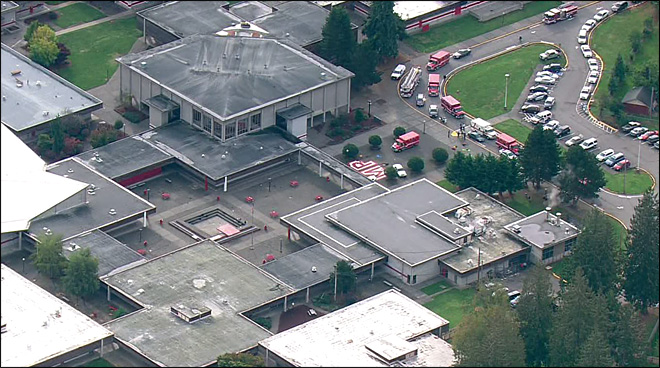Police and ambulances respond to a reported shooting at Marysville Pilchuck High School.
