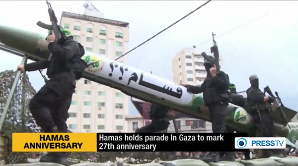 Thousands of armed Hamas troops showed off their military hardware at a Dec. 14, 2014 parade in Gaza, marking the organization's 27th anniversary. (Image source: PressTV video screenshot)