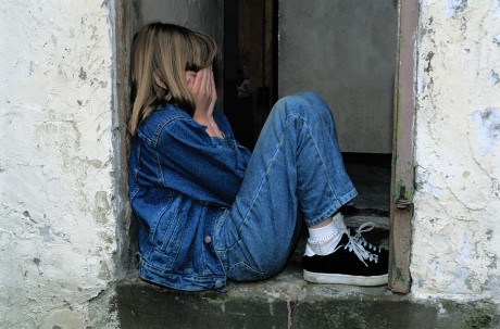 child-sitting-in-door-and-crying-public-domain-460x303